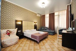 Кровать или кровати в номере Гостевой дом Мирабель