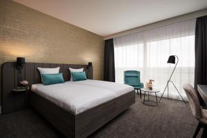 A bed or beds in a room at Van der Valk Hotel Brussels Airport