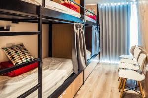 A bunk bed or bunk beds in a room at In Barcelos Hostel & Guest House