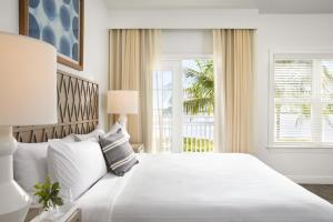 A bed or beds in a room at Parrot Key Hotel & Villas