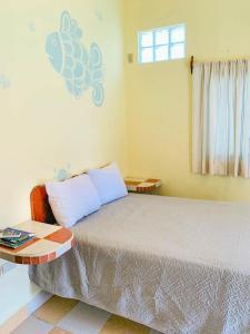 A bed or beds in a room at Departamento a una cuadra de la playa