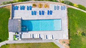 A view of the pool at Hotel De La Pyramide or nearby