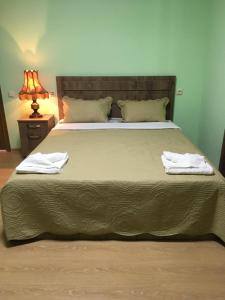 A bed or beds in a room at Green House