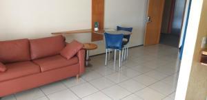A seating area at ApartHotel - Praia Mansa 1 e 2 Qtos