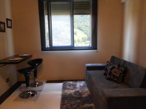 Uma área de estar em Flat no Hotel Cavalinho Branco