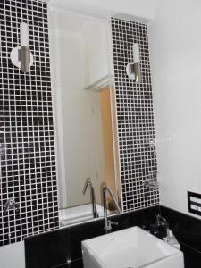 Um banheiro em Flat no Hotel Cavalinho Branco