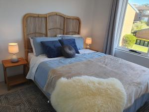 A bed or beds in a room at Play@PortMacq