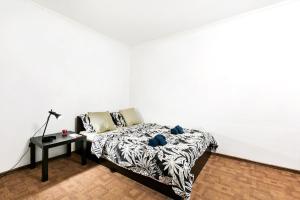 Кровать или кровати в номере Apartment Tsaritsyno