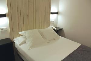 Cama o camas de una habitación en Hotel Lois