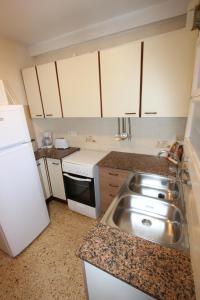 Een keuken of kitchenette bij Apartment Escor