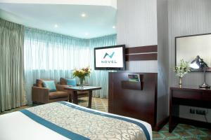 A television and/or entertainment center at Novel Hotel City Center