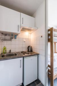 A kitchen or kitchenette at Chamonix Sud Studio