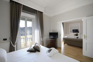 Ein Bett oder Betten in einem Zimmer der Unterkunft Grand Hotel Santa Lucia