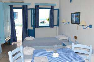 Ένα ή περισσότερα κρεβάτια σε δωμάτιο στο Galeana Beach Hotel