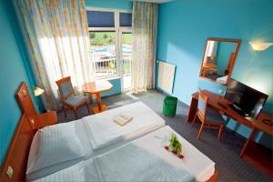 Un pat sau paturi într-o cameră la Terme Topolsica - Hotel Vesna