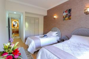 A bed or beds in a room at In Club Palmeraie Resorts