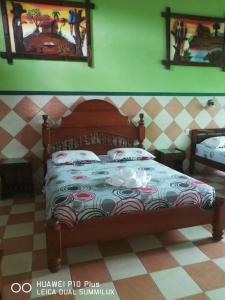 Cama o camas de una habitación en Hotel Pahuichi
