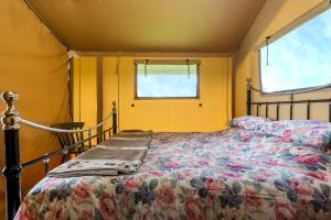 A bed or beds in a room at Kidwelly Glamping