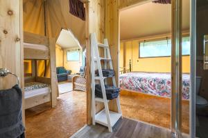 A bunk bed or bunk beds in a room at Kidwelly Glamping