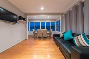 A seating area at Norm's Beach House - Airlie Beach