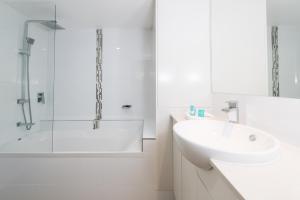 A bathroom at La Grande Apartments