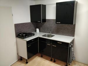 A kitchen or kitchenette at Op Stap