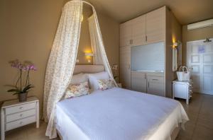 Ένα ή περισσότερα κρεβάτια σε δωμάτιο στο Nelly's Apartments