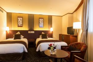 Tempat tidur dalam kamar di Shibuya Creston Hotel