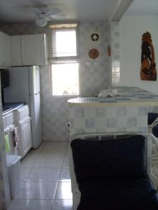 A kitchen or kitchenette at Oceanview Apartment 13c