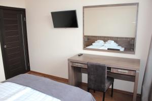Телевизор и/или развлекательный центр в Oka Hotel