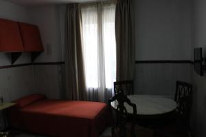 A bed or beds in a room at Don Paula