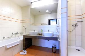 A bathroom at Hotel Tatra