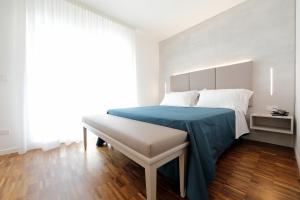 Postel nebo postele na pokoji v ubytování Hotel Simi Lan