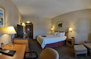 A bed or beds in a room at Humphry Inn and Suites