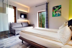 Letto o letti in una camera di Casa Antonelli