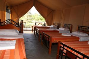 A bed or beds in a room at ELANGATA OLERAI LUXURY TENTED CAMP