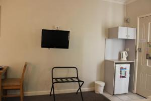 A television and/or entertainment center at The Hume Inn Motel