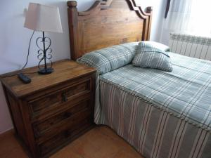 A bed or beds in a room at Hotel El Molino