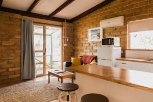 A seating area at Margaret River Holiday Cottages