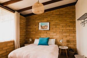 A bed or beds in a room at Margaret River Holiday Cottages