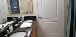 A bathroom at Cane Island Luxury Condo