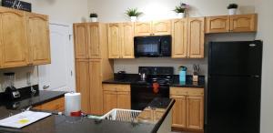 A kitchen or kitchenette at Cane Island Luxury Condo
