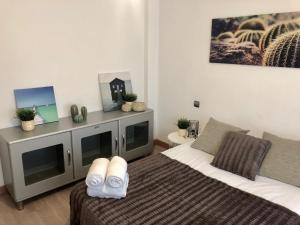 A bed or beds in a room at Apartamento Ana Isabel Herrero