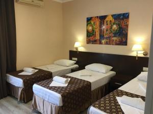 Кровать или кровати в номере Гостевой Дом Евразия