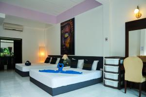 A bed or beds in a room at Wirason Residence