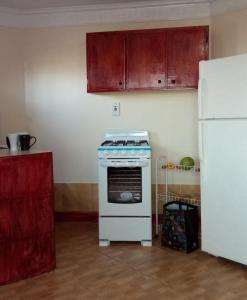 A kitchen or kitchenette at Hilltop Super Studio with Kingston View