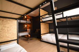 A bunk bed or bunk beds in a room at NK Hostel