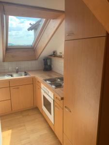 Küche/Küchenzeile in der Unterkunft Windhör