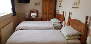 A bed or beds in a room at The New Inn