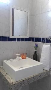 Um banheiro em Pousada Mari